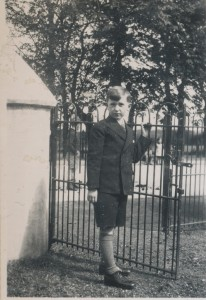 Eoin c. 1935 at gate of house copy