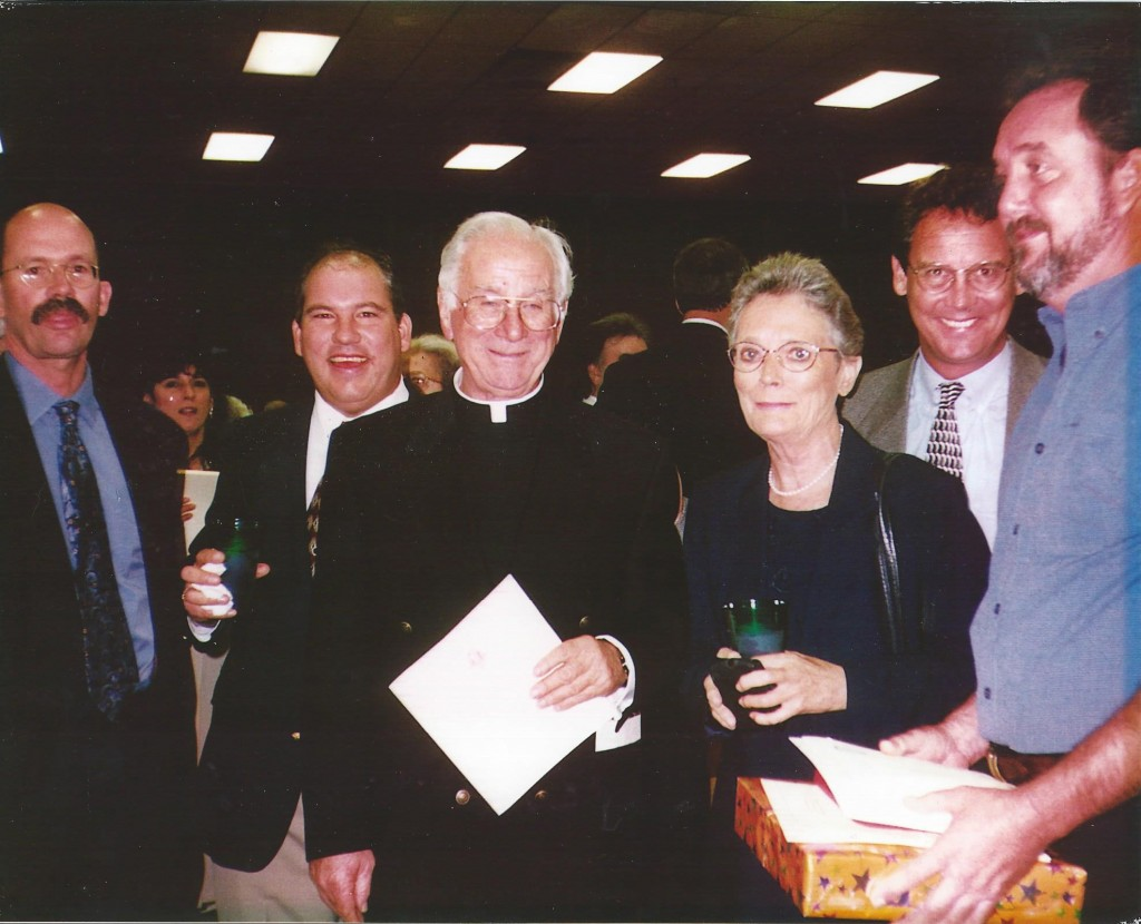 Monsignor with Murray Family